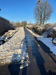 Pathway has been cleared of snow by practice staff and volunteers for patients